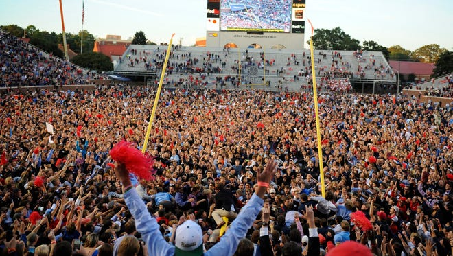 Oct 4, 2014; Oxford, MS, USA; Mississippi Rebels fans tear down the goal posts after a win against the Alabama Crimson Tide at Vaught-Hemingway Stadium. The Rebels won 23-17. Mandatory Credit: Christopher Hanewinckel-USA TODAY Sports