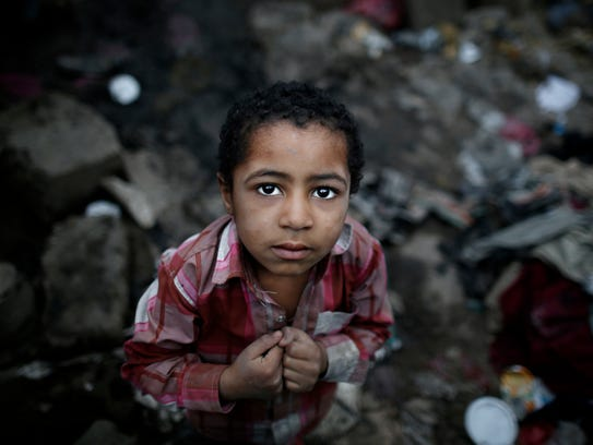 In this April 25, 2016 photo, a boy from the community