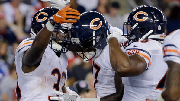 Chicago Bears running back Jeremy Langford, left, celebrates his touchdown with teammates during the first half of a preseason NFL football game against the New England Patriots Thursday, Aug. 18, 2016, in Foxborough, Mass. (AP Photo/Elise Amendola)