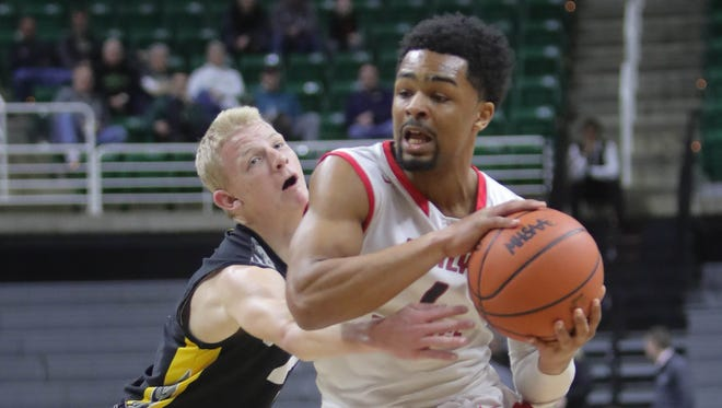 Detroit Edison guard Pierre Mitchell Jr. drives against Grand Rapids Covenant Christian guard Michael Altena during first period action of the Class C MHSAA semifinals Thursday, March 22, 2018 at the Breslin Center in East Lansing, Mich.
