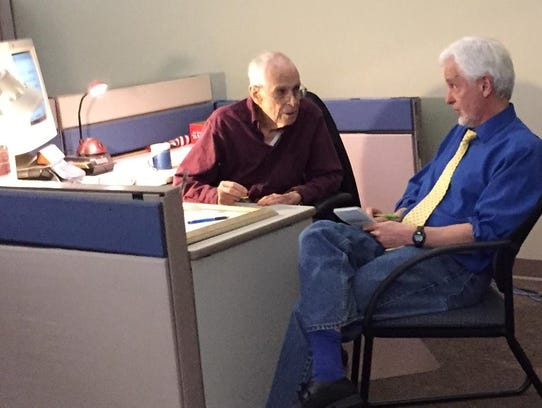 Hank Billings and Steve Pokin talk at Hank's desk in