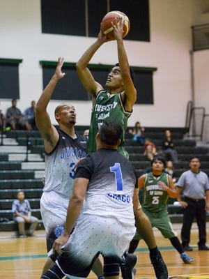 In this file photo, the University of Guam play Justice in a Guam Basketball Association game at the Phoenix Center. On Tuesday, UOG faces MVP on Triton Night, with the game starting at 6 p.m. at the UOG Calvo Field House.