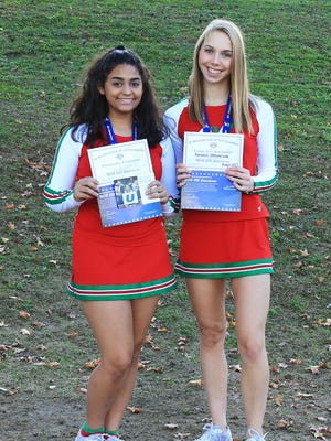 In their exclusive All-American cheer uniforms, East Brunswick High School cheer captains Nicole Carrera and Kendall Westbrook, both 17, will represent their hometown and state in the Spirit Spectacular at Walt Disney World in Orlando, Florida.