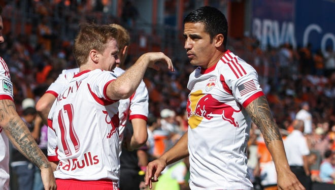 New York Red Bulls midfielder Tim Cahill, right, reacts after scoring a goal during the first half against the Houston Dynamo at BBVA Compass Stadium.