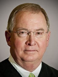 Former state Supreme Court Justice George C. Carlson Jr. says it's impossible to keep politics out of judicial elections.