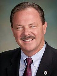 Scottsdale Mayor Jim Lane cast praise on the Scottsdale Unified School District, which faces a barrage of complaints, during his State of the City address on Wednesday.