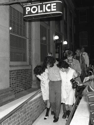 In 1981, Brinks heist suspects Kathy Boudin, David Gilbert and Judith Clark are led from Nyack police headquarters after arraignment on murder charges.