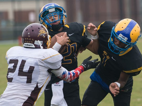 Wi-Hi's Raekwon McCarter (21) attempts to break a tackle