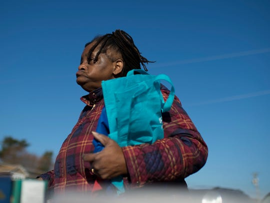 Renee Finney of Glassboro gets her bags ready to fill up with food from the Food Bank of South Jersey Thursday, Dec. 21, 2017 in Glassboro, New Jersey. Parts of Glassboro is considered a 'food desert' by the USDA.