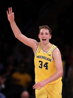 Michigan forward Mark Donnal (34) celebrates a three-point basket during the first half Friday in New York.