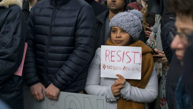 Protesters assemble at John F. Kennedy International Airport in New York, Saturday, after two Iraqi refugees were detained while trying to enter the country. A protest at the Indianapolis International Airport is planned for Sunday afternoon.