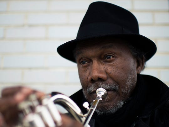 """John Berry, 72, was born and raised in Bridgeton. Currently a Vineland resident, he sets time aside some days to play his trumpet and flugelhorn next to his """"Jesus"""" sign under an abandoned gas station on Delsea Ave in Vineland."""