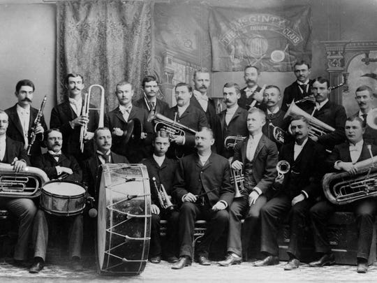 This photograph, taken in the 1890s, shows the old McGinty Club band in all its flower. Front row, seated from left are: Fred Edelston, T. Offley, Louis Behr, Hester Jr., Hester Sr. (the leader), W.W. Bridgers, Billy Watts and Charles Layer. Back row, from left: J. Holmes, Ray Pollard, Edward Watts, H. Smith, professor Carl Pitzer (who became leader later), Z.F. Merrill, Will R. Brown, J.D. Ponder, A.V. Lebreton, V. Black, Charles Reed and Jim Gibbs.