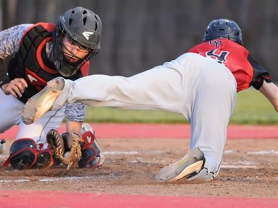 Sophomore Kam Peters evades Frontier catcher Jarrett