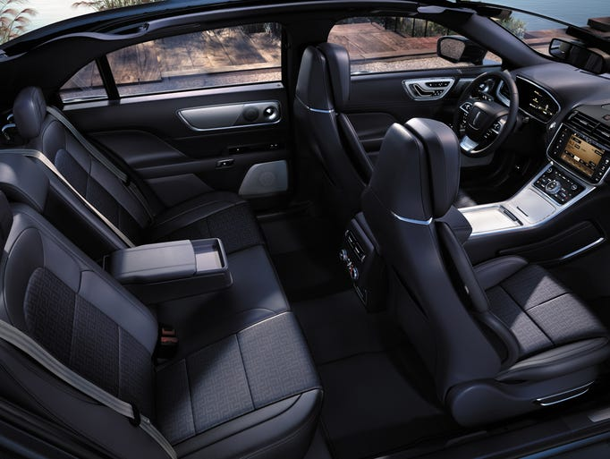photos lincoln creates 39 rhapsody 39 blue interior for continental. Black Bedroom Furniture Sets. Home Design Ideas