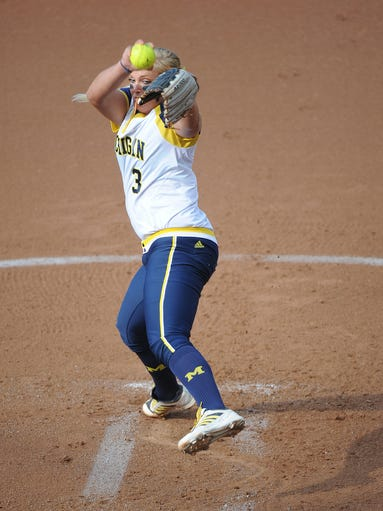 Michigan starting pitcher Megan Betsa throws against