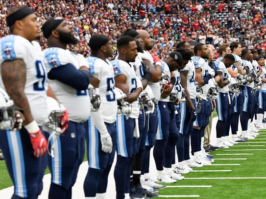 The Titans stand during the National Anthem before