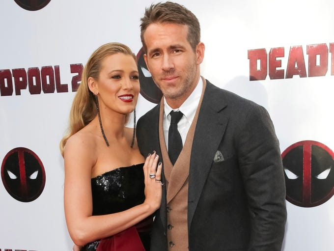 Actors Blake Lively, left, and Ryan Reynolds attend