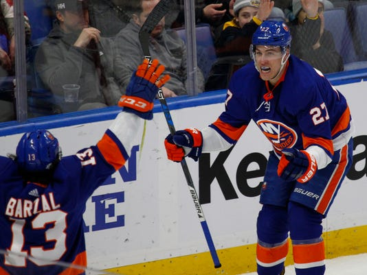 New York Islanders Mathew Barzal (13) and Anders Lee (27) celebrate a goal during the third period of the team's NHL hockey game against the Buffalo Sabres, Thursday, Feb. 8, 2018, in Buffalo, N.Y. (AP Photo/Jeffrey T. Barnes)