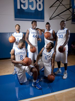 Kentucky Wildcats Marcus Lee (00) James Young (1) Aaron Harrison (2) Andrew Harrison (5) Julius Randle (30) and Dakari Johnson (44) pose for pictures during Kentucky Media Day at the Joe Craft Center. (Dominique Hawkins and Derek Willis not pictured)