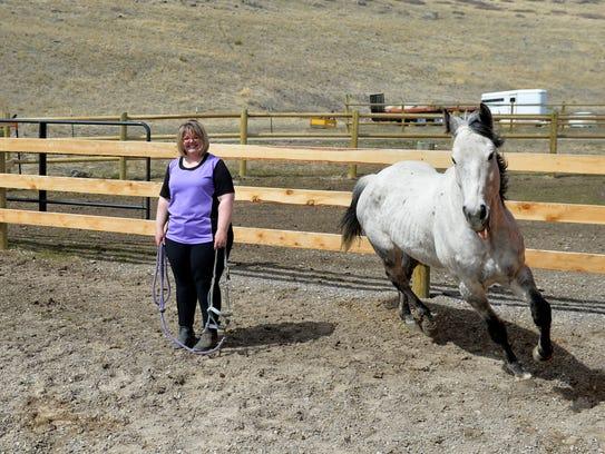 Kelly Speidel's horse, Bullet, trots laps around Kelly
