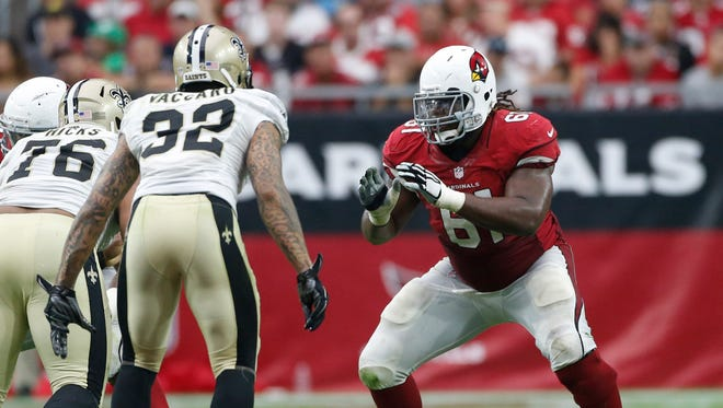 Arizona Cardinals guard Jonathan Cooper blocks against the New Orleans Saints in NFL action at University of Phoenix Stadium in Glendale on September 13, 2015.