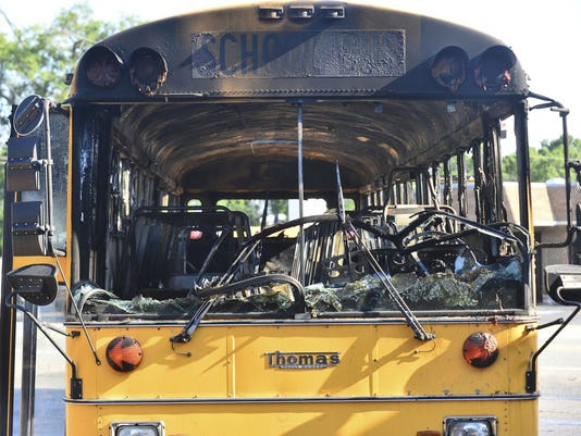 636504926080358047-Burned-bus.jpg