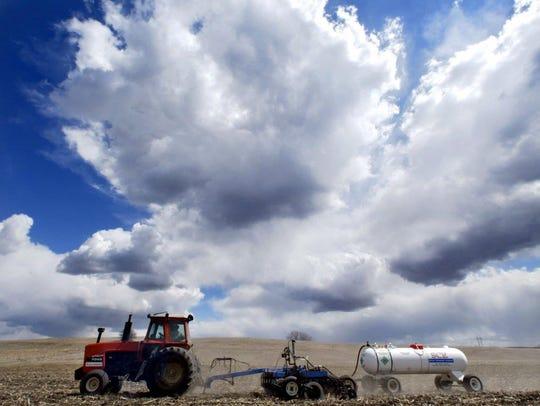 The Iowa sky over vast farm fields.