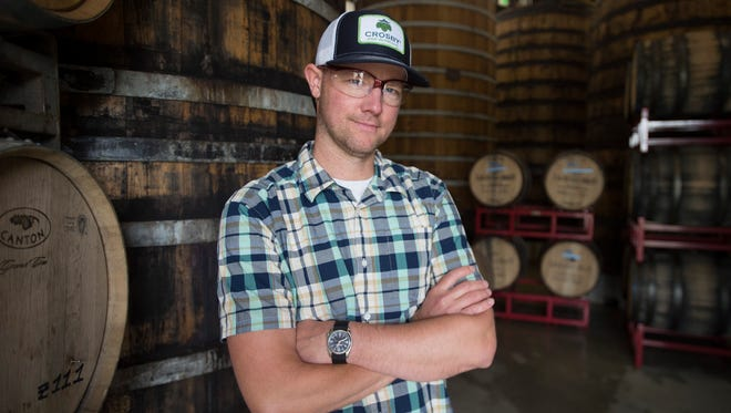 Production Brewmaster Christian Holbrook poses for a photo in the barrel room at New Belgium Brewing in Fort Collins on Tuesday, May 29, 2018.