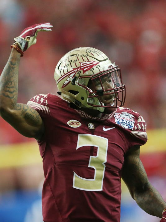 FILE- In this Dec. 31, 2015, file photo, Florida State defensive back Derwin James (3) celebrates a tackle during the second half of the Peach Bowl NCAA college football game, in Atlanta. James is part of the reason why the Seminoles have national title hopes. At 6-foot-3 and 211 pounds, he is the prototype for that combo defensive back-linebacker hybrid that has become such a vital piece in defending spread offenses. (AP Photo/John Bazemore, File)