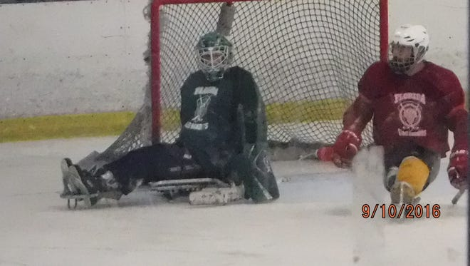 Marc Robichaud, in green, along with double-amputee Dan Robbins, a former Naples resident now living in Lake Worth running his own Sled Hockey program.