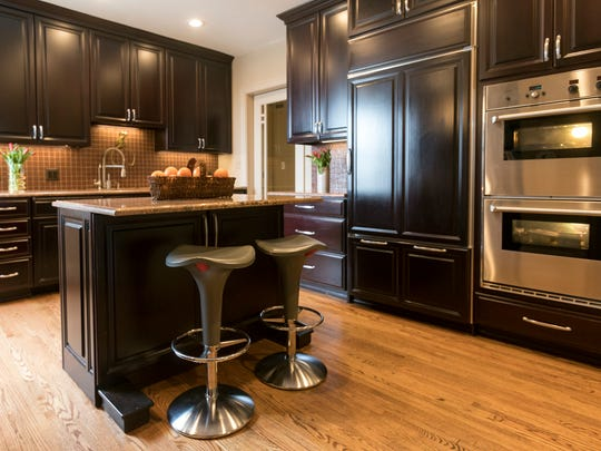 The kitchen has a new oak floor and high-end appliances. The door in the background opens to a long butler's pantry.