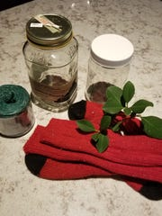 Materials for sock=covered tea lights include, of course, colorful socks and jars.