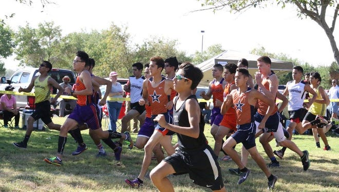 Hanks freshman Michael Abeyta (in sun glasses) won District 2-5A race in a time of 16:06.49. The Knights finished second and a trip to regionals Saturday in Lubbock.