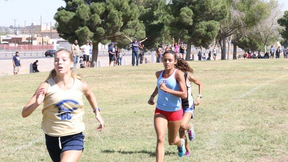 In the closest race of the day, Coronado sophomore Janelle Jaeger-Darakjy out-kicked Socorro junior Natalie Gomez to win the District 1-6A championship in  19:25.39. Gomes was second in 19:26.14.