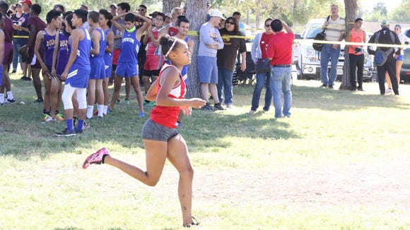 Jefferson senior Brooke Woodson won the District 1-5A race in 19:59.02 as the Foxes defending it's team title.
