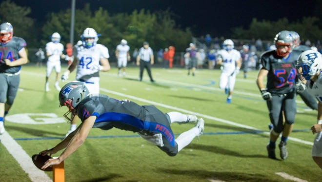 Clark Gray leaps into the end zone.
