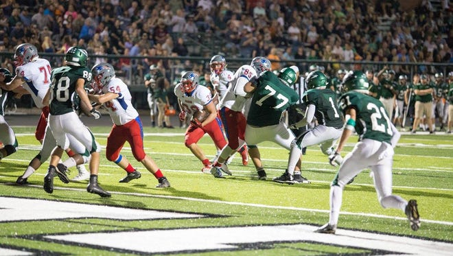 Senior running back Ty Snelson picks a hole on the way to the end zone.
