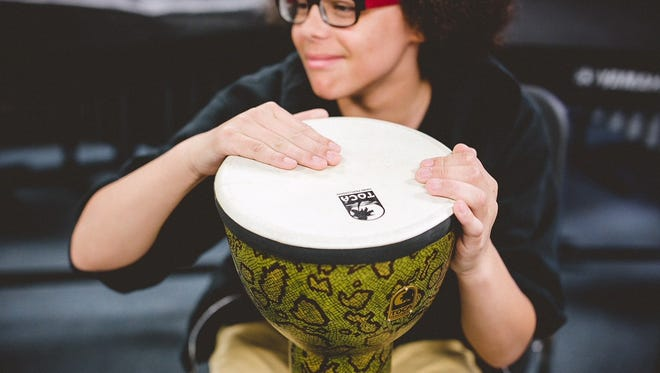 CMCSS student playing drum
