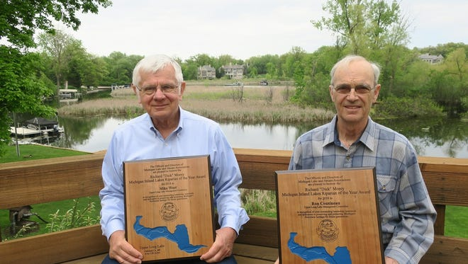 Upper Long Lake residents Mike West (left) and Ron Cousineau were named Riparians of the Year by the Michigan Lake and Stream Associations for their battle against phragmites.