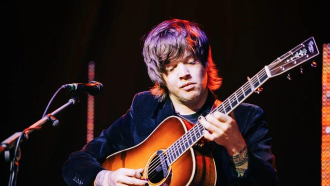 Bluegrass guitarist and Michigan native Billy Strings, pictured performing here, is nominated for a Grammy this year.