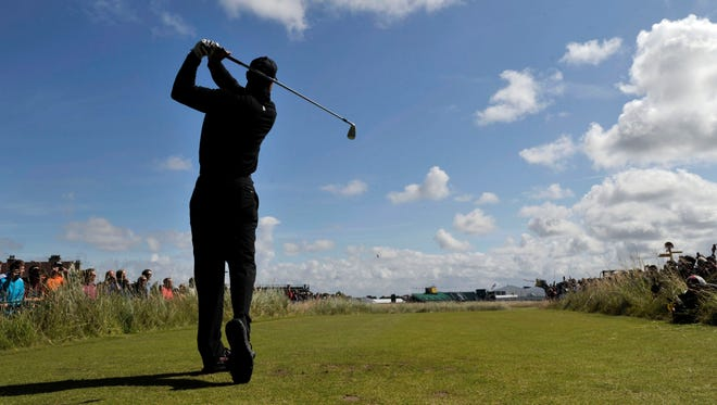 Three-time British Open winner Tiger Woods tees off at the 18th during a practice round for the 143rd Open Championship at the Royal Liverpool Golf Club.