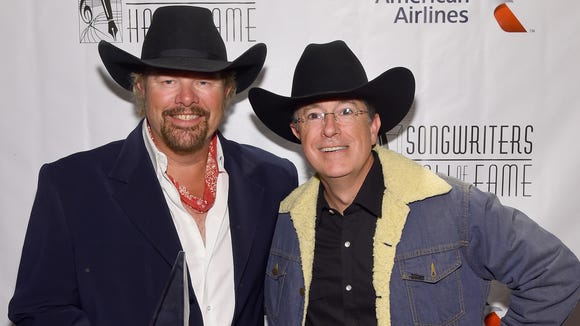 Toby Keith and Stephen Colbert at the Songwriters Hall Of Fame in New York in June.