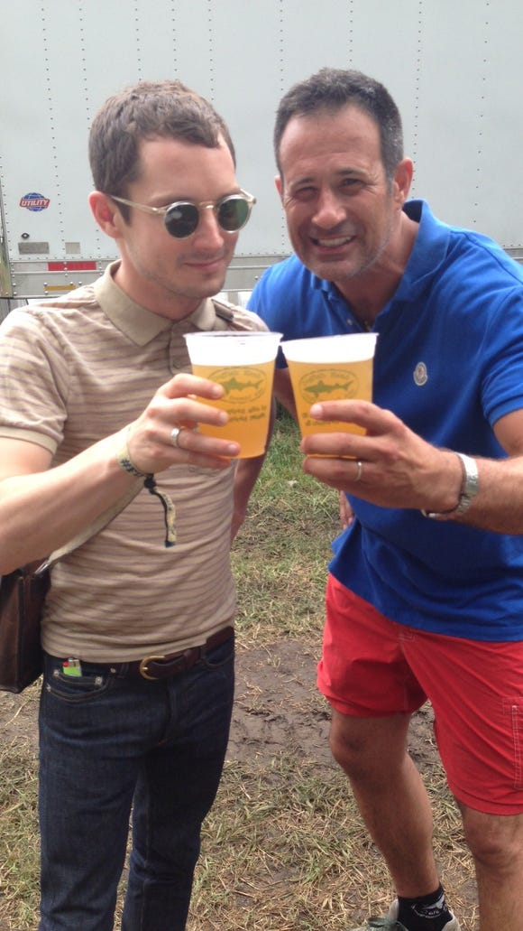 Actor Elijah Wood (left)  has a beer in 2013 with Dogfish Head founder Sam Caligione.