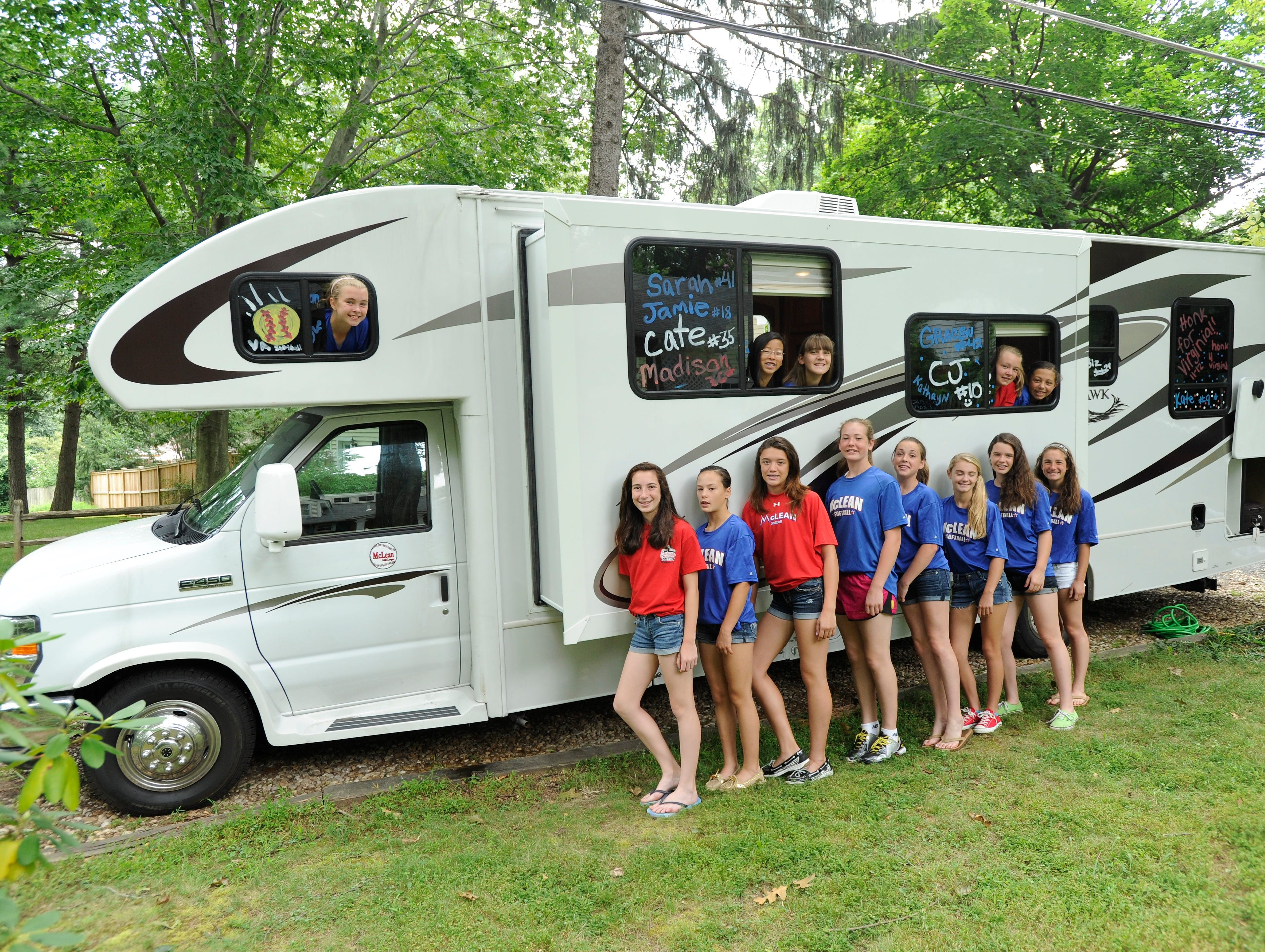 USA TODAY reporter Jayne O'Donnell drove 1,400 miles in a rented RV with six teenage girls. The Virginia all-star softball team that traveled in the rented Jayco Greyhawk RV, are, looking out of windows from left, Kate Haas, left, Jamie Wang, Sarah Stahlman, Gracen Govan and Gabi Norton.  Standing are, from left, Rachel Remer, Riley Simon, Madison Wolfe, Kathryn Sandercock, Cate Willing, Caitlin Jorae, Elizabeth Hoeymans, and Julia Jones.