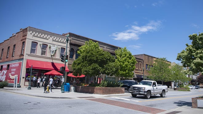 Shoppers and diners walk up and down Main Street in downtown Hendersonville on May 15. Hendersonville City Council voted to close Main Street during certain weekends through October in order to give downtown businesses more space for social distancing.