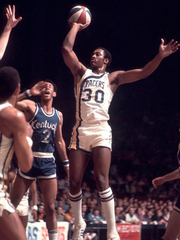 McGinnis displayed his unusual one-handed jump shot as a member of the Indiana Pacers during the 1972-73 season against the Kentucky Colonels.