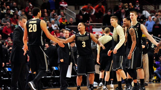 Purdue Boilermakers guard P.J. Thompson (3) celebrates with center A.J. Hammons (20) as they enter a timeout against the Wisconsin Badgers during the first half in the semifinals of the Big Ten Tournament at United Center.
