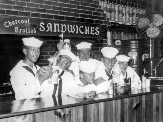 A group of sailors enjoy some time off at Taylor Pork Roll.