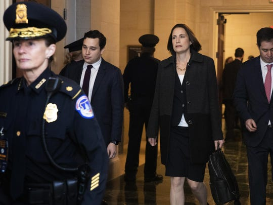Former White House national security aide Fiona Hill, arrives to testify before the House Intelligence Committee on Capitol Hill in Washington, Thursday, Nov. 21, 2019, during a public impeachment hearing of President Donald Trump's efforts to tie U.S. aid for Ukraine to investigations of his political opponents. (AP Photo/Manuel Balce Ceneta)